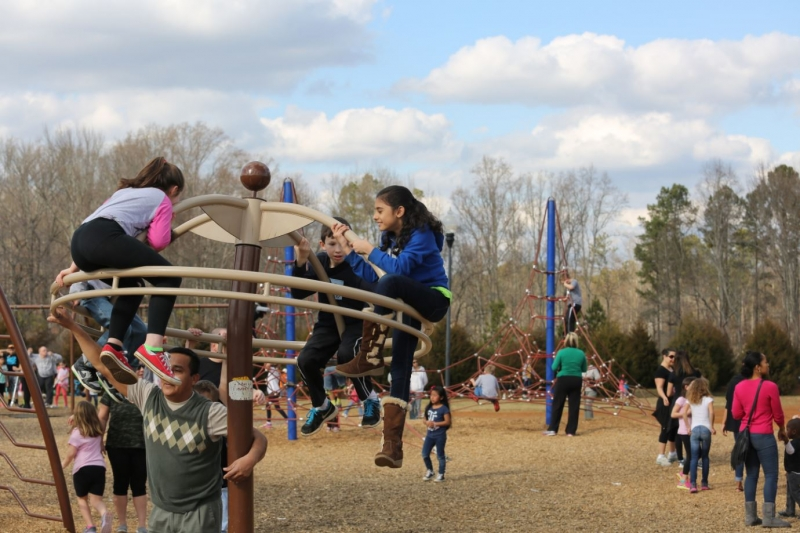 Kids in play area of swift-central-park in Kennesaw